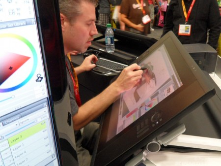 A guy demonstating the wacom cintiq